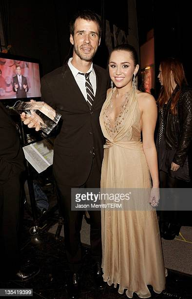 Award recepient Jamie Tworkowski of the charity To Write Love on her Arms and Actress/singer Miley Cyrus attends the American Giving Awards presented...