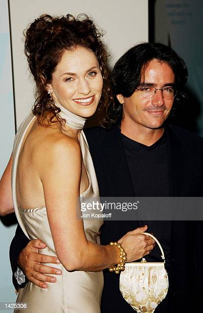 Award recipient actress Amy Brenneman poses with director Brad Silberling during the Women In Film Celebrates The Crystal and Lucy Awards on...