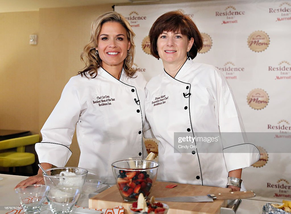 Award recipient, chef and lifestyle entrepreneur Cat Cora poses with Residence Inn by Marriott VP and Global Brand Manager, Diane Mayer at the 2013 Resident Mom of the Year event at Residence Inn by Marriott on May 3, 2013 in New York City.