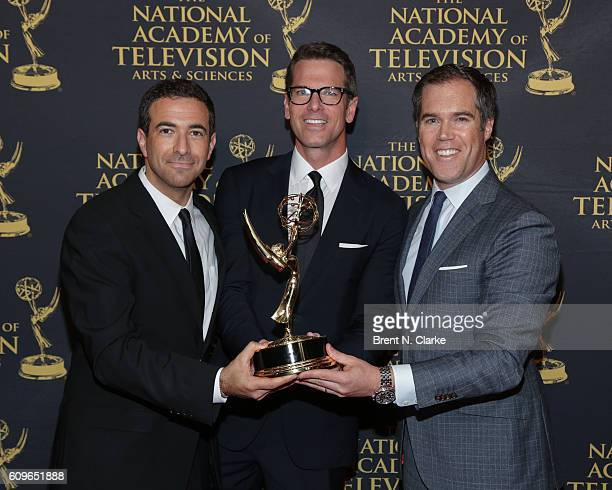 Award recipients for outstanding coverage of a live news story Ari Melber Thomas Roberts and Peter Alexander pose during the 37th Annual News and...