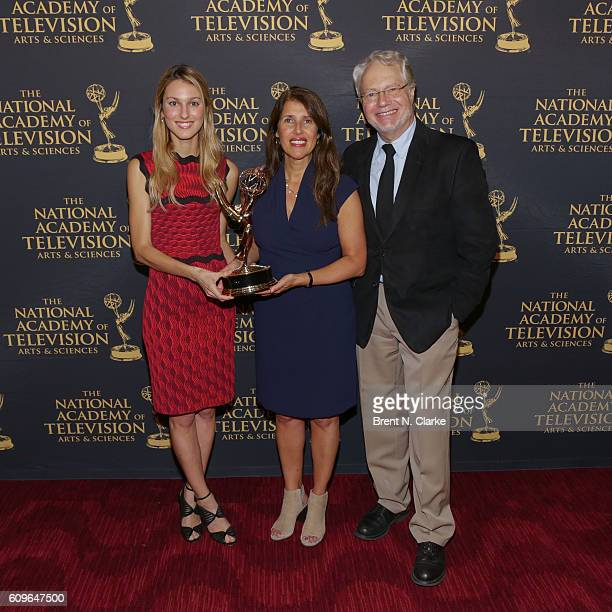 Award recipients for outstanding investigative reporting for a news magazine Nieves Zuberbuhler Shari Finkelstein and Bob Shattuck pose during the...
