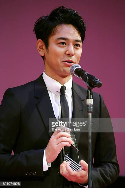 ARIGATO Award winner actor Satoshi Tsumabuki speaks on stage during the award ceremony of the Tokyo International Film Festival at the EX Theater...