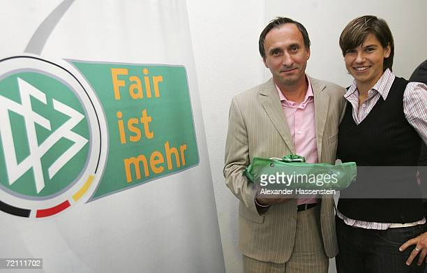 Award winner Adam Richter poses with football player Ariane Hingst during the DFB German Football Federation campaign Fair ist mehr meeting on...