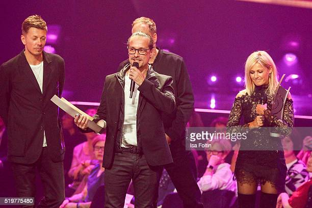Award winner Alex Christensen speaks on stage while Michi Beck Smudo and Helene Fischer listen during the Echo Award 2016 show on April 07 2016 in...