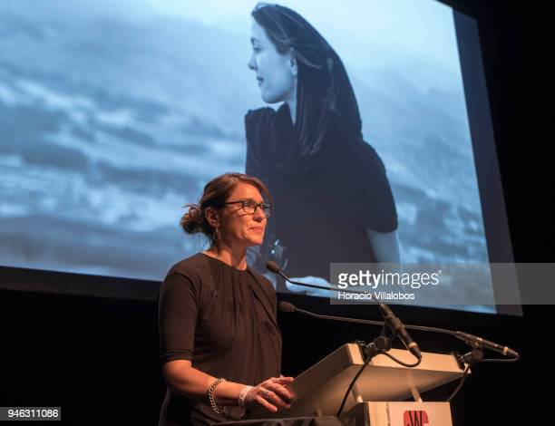 Award winner Andrea Bruce delivers remarks after having received the prize at the 2018 IWMF Anja Niedringhaus Courage In Photojournalism Awards...