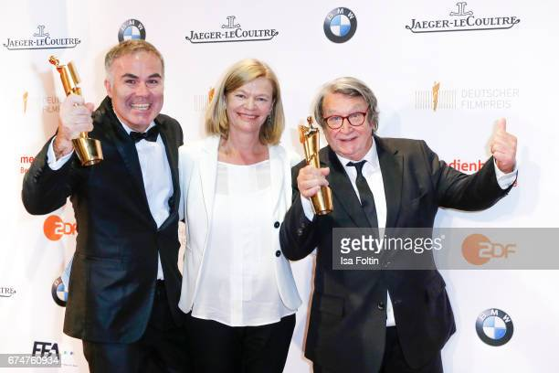 Award winner best documentary film StefanTolz, Heidi Specogna and Peter Spoerri at the Lola - German Film Award winners board at Messe Berlin on...