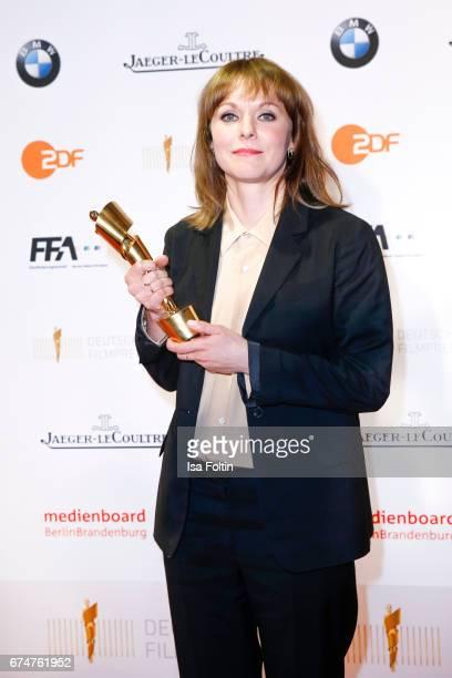 Award winner best film gold for 'Toni Erdmann' director Maren Ade at the Lola - German Film Award winners board at Messe Berlin on April 28, 2017 in...