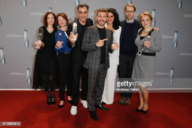 Award winner best series 'Brüder' with actor Edin Hasanovic and cast pose with their awards during the German Television Award at Palladium on...