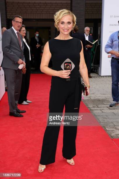 Award winner Caren Miosga poses with her trophy as she attends the annual Grimme Award on August 27, 2021 in Marl, Germany.