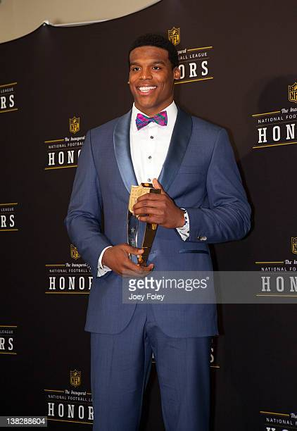 Award winner Carolina Panthers quarterback Cam Newton poses for a photo after the show in the press room at the 2012 NFL Honors at the Murat Theatre...