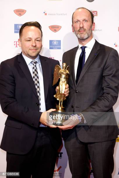 Award winner Daniel Roeder and Alexander Feiherr Knigge during the VDZ Publishers' Night at Deutsche Telekom's representative office on November 6...