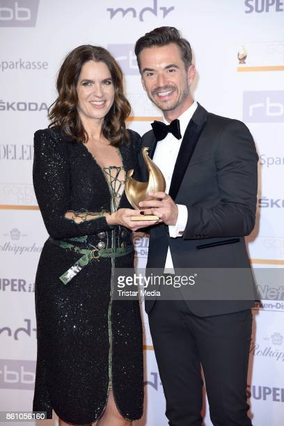 Award winner Florian Silbereisen and presenter Katarina Witt attend the Goldene Henne on October 13 2017 in Leipzig Germany