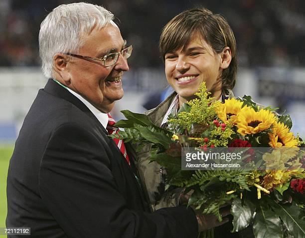 Award winner footballer Ariane Hingst poses with Theo Zwanziger President of the German Football Federation during the DFB German Football Federation...