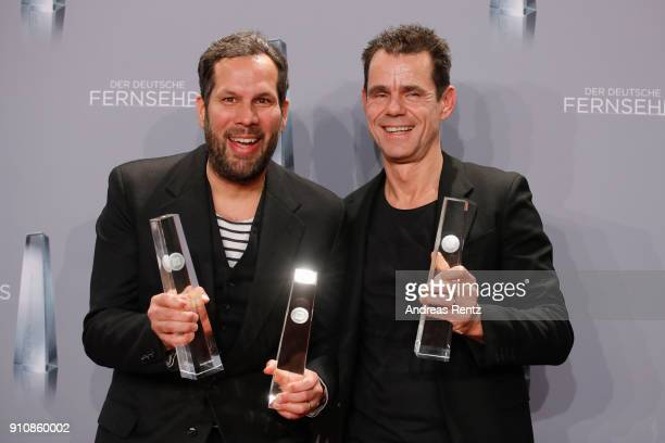 Award winner for best drama Achim von Borries and Tom Tykwer pose with their awards during the German Television Award at Palladium on January 26...