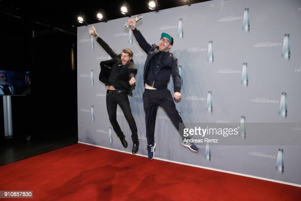Award winner for best entertainment primetime Thore Schoelermann and Mark Forster pose with their awards during the German Television Award at...