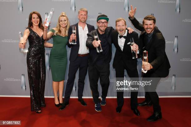 Award winner for best entertainment primetime Thore Schoelermann and Mark Forster and their team pose with their awards during the German Television...