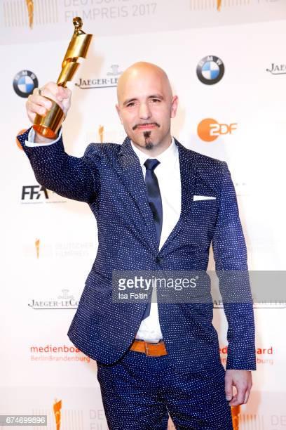 Award winner for best film music in 'Das kalte Herz' Oli Biehler at the Lola - German Film Award winners board at Messe Berlin on April 28, 2017 in...