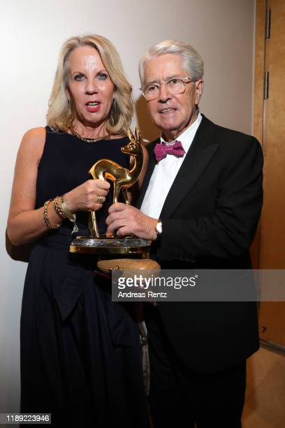 Award winner Frank Elstner and his wife Britta Gessler pose during the 71st Bambi Awards show at Festspielhaus Baden-Baden on November 21, 2019 in...