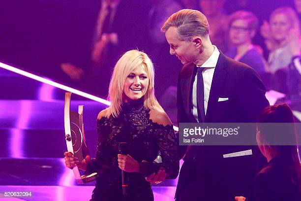Award winner Helene Fischer and Max Raabe are seen on stage during the Echo Award 2016 show on April 07 2016 in Berlin Germany