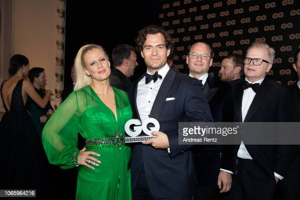 Award winner Henry Cavill and host Barbara Schoeneberger seen on stage during the GQ Men of the Year Award show at Komische Oper on November 08 2018...