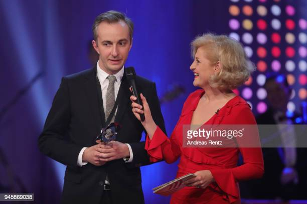 Award winner Jan Boehmermann chats with host Annette Gerlach during the 54th Grimme Award on April 13 2018 in Marl Germany