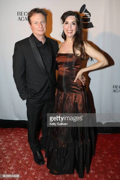 Award winner Laura Sullivan poses for a photo with husband Eric Sullivan on the red carpet at the San Francisco 60th GRAMMY Award Nominee Celebration...