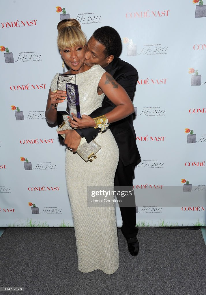 Award winner Mary J. Blige and Kendu Isaacs pose backstage at the 2011 FiFi Awards at The Tent at Lincoln Center on May 25, 2011 in New York City.