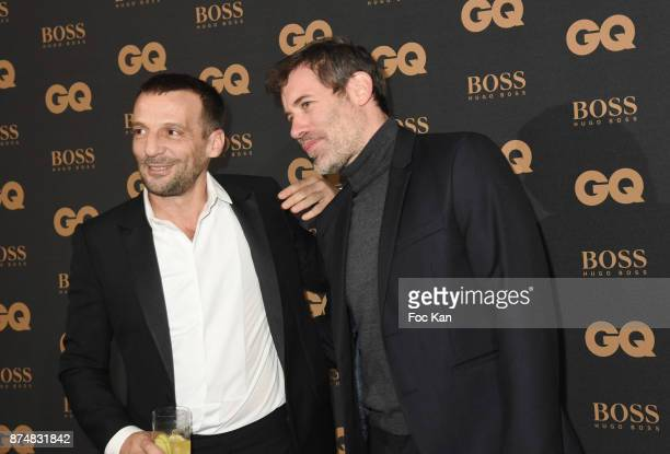 GQ 2017 award winner Mathieu Kassovitz and Jalil Lespert attend the Les GQ Men Of The Year Awards 2017 Photocall at Trianon on November 15 2017 in...