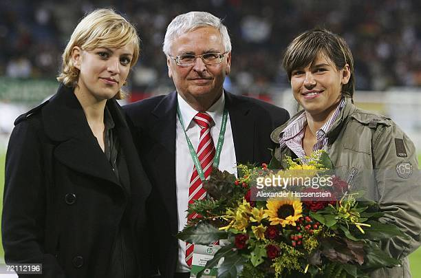 Award winner Miriam Bollmann and footballer Ariane Hingst pose with Theo Zwanziger President of the German Football Federation during the DFB German...