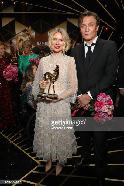 Award winner Naomi Watts poses with Oliver Masucci during the 71st Bambi Awards show at Festspielhaus Baden-Baden on November 21, 2019 in...