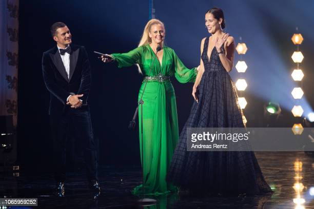 Award winner Orlando Bloom host Barbara Schoenberger and Ana Ivanovic seen on stage during the GQ Men of the Year Award show at Komische Oper on...