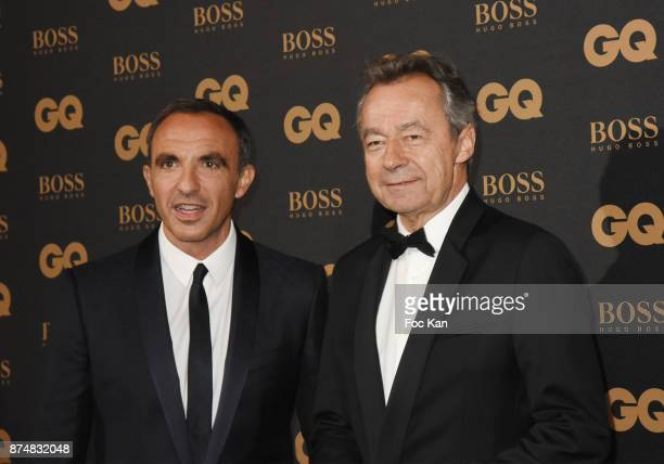 GQ 2017 award winner presenter Nikos Aliagas and Michel Denisot attend the Les GQ Men Of The Year Awards 2017 Photocall at Trianon on November 15...