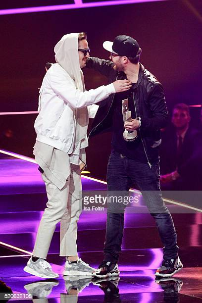Award winner Robin Schulz and Mark Forster embrace each other on stage at the Echo Award 2016 show on April 07 2016 in Berlin Germany