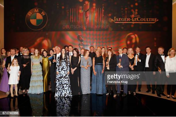 Award winner standing on stage together after the ceremony at the Lola German Film Award show at Messe Berlin on April 28 2017 in Berlin Germany