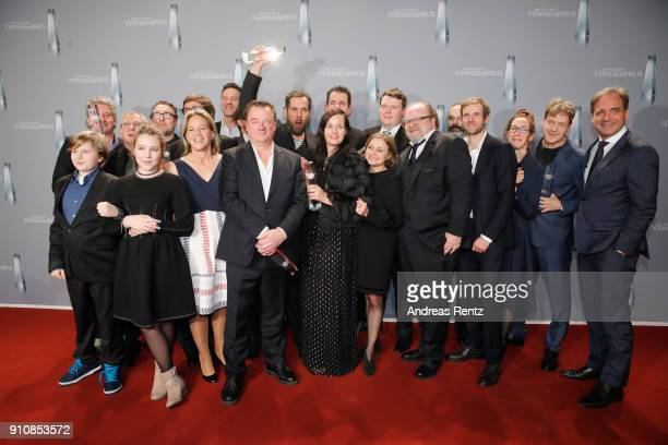 Award winner Tom Tykwer and the team of Babylon Berlin pose with their awards during the German Television Award at Palladium on January 26 2018 in...
