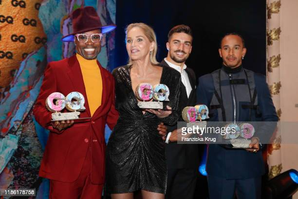 Award winners Billy Porter Sharon Stone Mariano Di Vaio and Lewis Hamilton on stage during the GQ Men of the Year Award show at Komische Oper on...