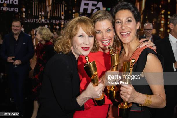 Award winners Birgit Minichmayer, Marie Baeumer and Emily Atef pose on stage during the Lola - German Film Award show at Messe Berlin on April 27,...