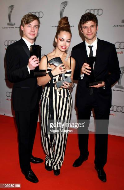 Award winners David Kross Aura Dione and Thomas Mueller pose with their trophys during the Audi Generation Award 2010 at Hotel Bayerischer Hof on...