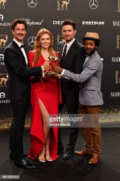 Award winners Eric Kabongo director Simon Verhoeven Palina Rojinski and Florian David Fitz showing their Bambi which they won in the 'National film'...