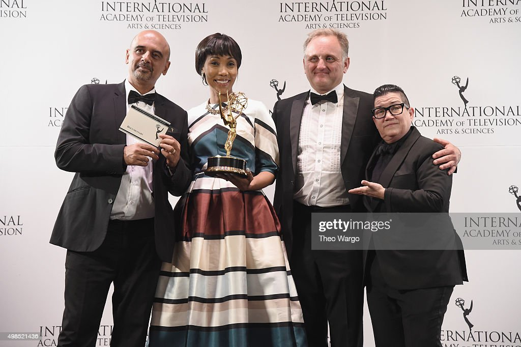 Award Winners for Documentary for 'Miners Shot Down' including director Rehad Desai (L) actress Lala Tuku, and Cinematographer Jonathan Kovel (2nd R) celebrate with presenter Lea DeLaria (R) at 43rd International Emmy Awards at New York Hilton on November 23, 2015 in New York City.