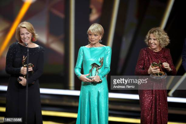 Award winners Gaby Dohm Uschi Glas and Michaela May pose on stage during the 71st Bambi Awards show at Festspielhaus BadenBaden on November 21 2019...