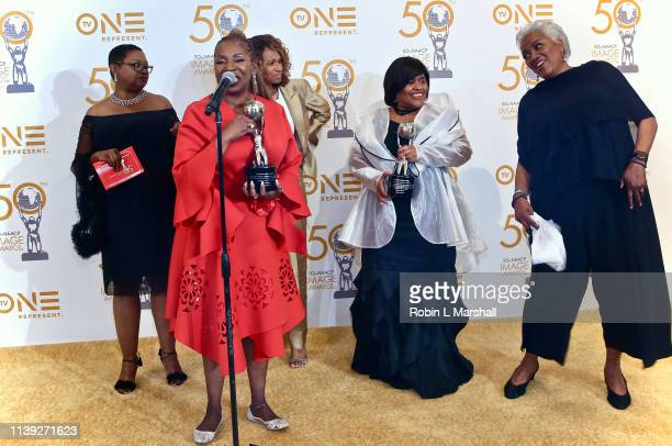 NAACP Award winners Iyanla Vanzant Leah Daughtry Yolanda Caraway Minyon Moore and Donna Brasile celebrate in the press room at The Beverly Hilton on...