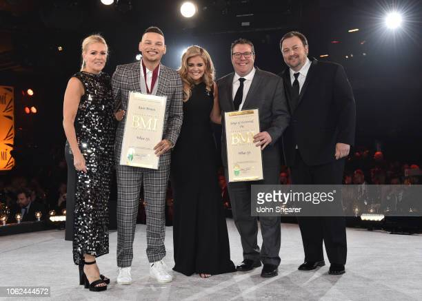 Award winners Kane Brown and Lauren Alaina pose with Leslie Roberts Kent Earls and Mason Hunter onstage at the BMI Country Awards 2018 at BMI...