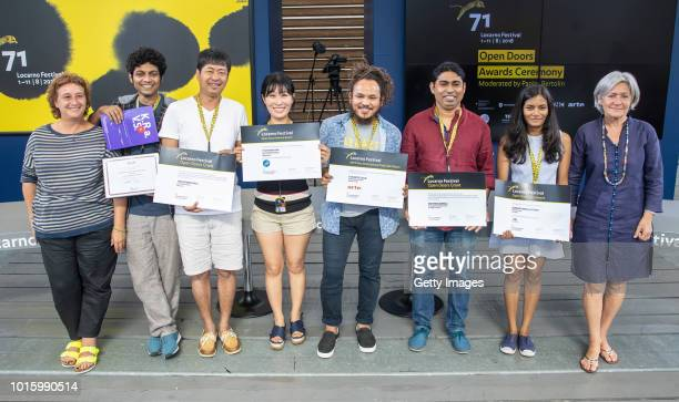Award winners pose at the Open Doors Award Ceremony during the 71st Locarno Film Festival on August 7 2018 in Locarno Switzerland