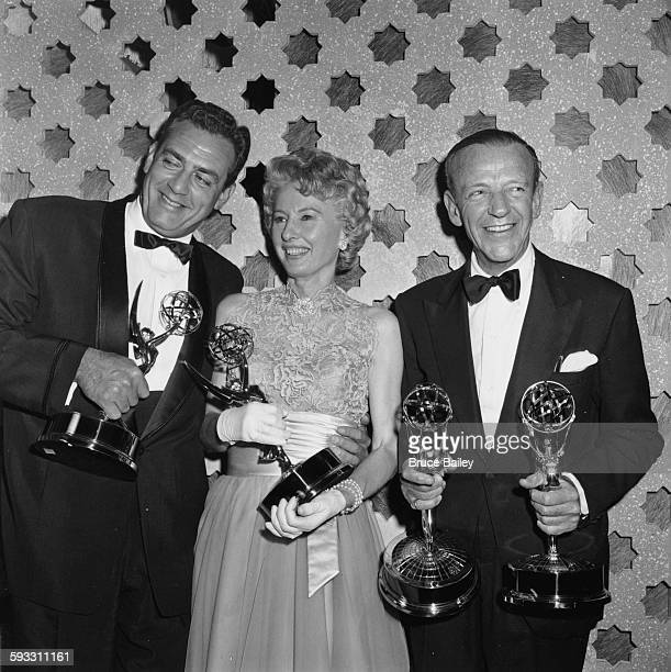 Award winners Raymond Burr Barbara Stanwyck and Fred Astaire holding their statuettes at the Emmy Awards May 1961