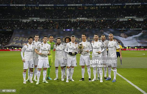 FIFA award winners Toni Kroos Cristiano Ronaldo Sergio Ramos and James Rodriguez of Real Madrid pose with team mates before the Copa del Rey round of...