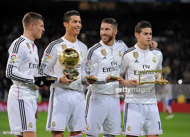 FIFA award winners Toni Kroos Cristiano Ronaldo Sergio Ramos and James Rodriguez smile before the Copa del Rey Round of 16 Second leg match between...