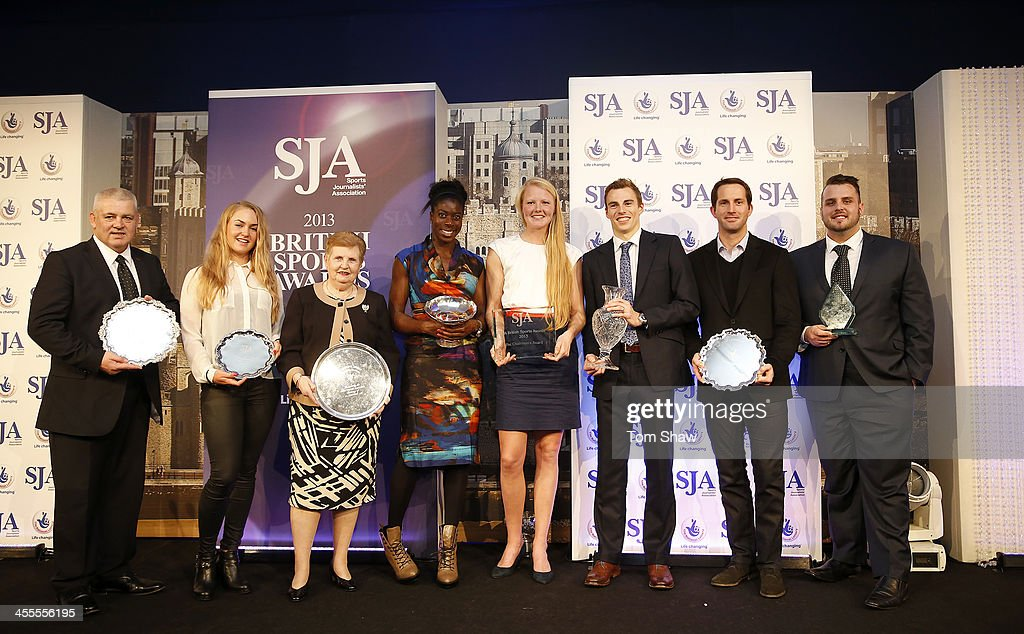 SJA award winners Warren Gatland, Charley Hull, Dame Diana Ellis, Christine Ohuruogu, Polly Swann, Nick Matthew, Sir Ben Ainslie and Aled Davies all pose with their awards during the SJA British Sports Awards at Tower of London on December 12, 2013 in London, England.