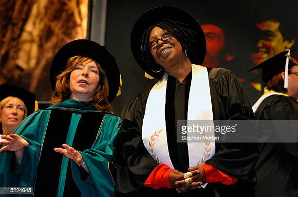 Award winning actor Whoopi Goldberg listens along with SCAD President Paula Wallace as nearly 1,700 graduates at the Savannah College of Art and...