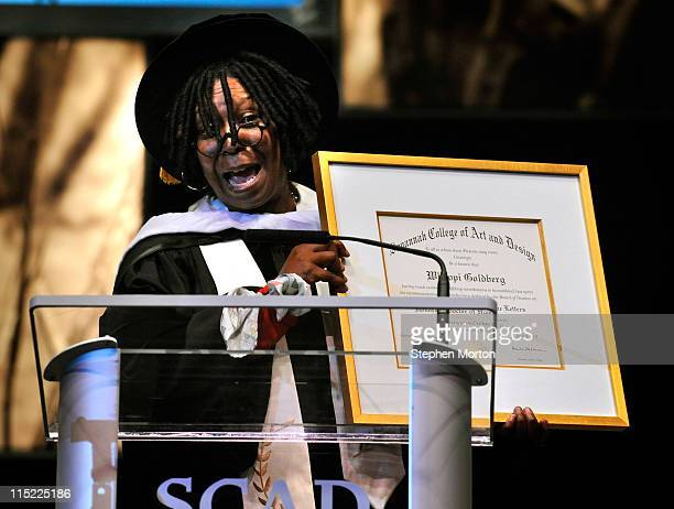 Award winning actor Whoopi Goldberg reacts after she receives a honorary degree during the 2011 Savannah College Of Art And Design graduation...